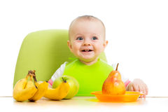 Baby eating fruits Stock Image
