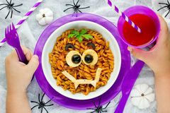 Baby eating, funny and healthy meal concept. Pasta bolognese on Stock Image