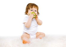Baby eating green apple Stock Images