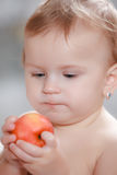 Baby eating healthy food Stock Photos