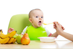 Baby eating healthy food fruits. Baby girl eating healthy food fruits Royalty Free Stock Photo