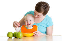 Baby eating healthy food with mother Royalty Free Stock Photography