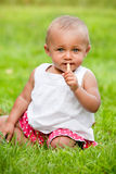 Baby is eating her cookie Stock Image