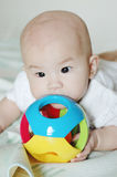 Baby eating her toy Royalty Free Stock Image