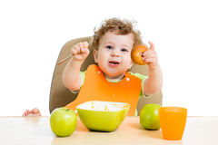 Baby eating by himself Royalty Free Stock Images