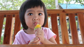 Baby eating ice cream stock video