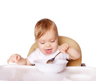 Baby eating with the left hand Royalty Free Stock Images