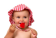 Baby eating lollipop Royalty Free Stock Images