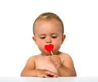 Baby eating lollipop Stock Image