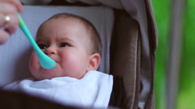 Baby eating in nature stock video footage
