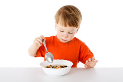 Baby eating the oatmeal Stock Photo