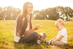 Baby eating outdoors Royalty Free Stock Photos