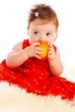 Baby eating peach Royalty Free Stock Photos