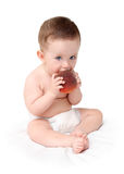 Baby eating peach. Sitting baby eating peach isolated on white Royalty Free Stock Images