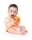 Baby eating peach. Sitting baby eating peach isolated on white Stock Image