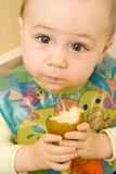 Baby Eating a Pear Royalty Free Stock Images