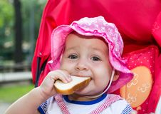 Baby eating a piece of bread Stock Photography