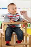 Baby eating porridge Royalty Free Stock Photography