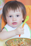 Baby eating ragout Royalty Free Stock Photography