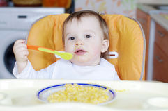 Baby eating rice-milk with pumpkin Royalty Free Stock Image