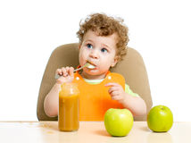 Baby eating sauce by himself Stock Photo