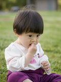 Baby eating snack Stock Photos