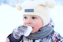 Baby eating snow Royalty Free Stock Photography