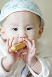 Baby eating solid food. A chinese baby eating solid food Royalty Free Stock Images