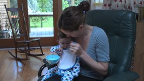 Baby eating solid food stock video