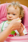 Baby eating spinach Royalty Free Stock Photos