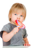 Baby eating a sticky lollipop Royalty Free Stock Image