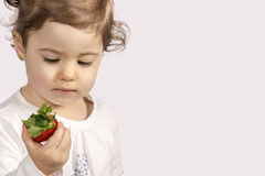Baby eating strawberry Royalty Free Stock Images