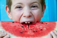 Baby eating watermelon slice. Child with slice of watermelon Royalty Free Stock Image