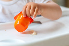 Baby eating yogurt Royalty Free Stock Images