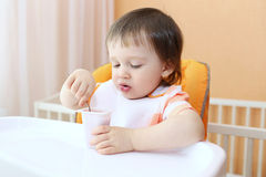 Baby eating youghourt Royalty Free Stock Image