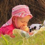 Baby eats apple Royalty Free Stock Photography