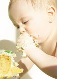 Baby eats birthday cake Royalty Free Stock Photos