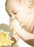 Baby eats birthday cake royalty free stock photos