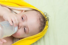 Baby eats from a bottle Stock Photo