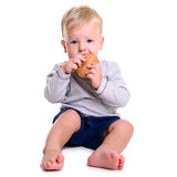 Baby eats bread Royalty Free Stock Image