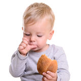 Baby eats bread Royalty Free Stock Photo