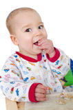 Baby eats a butter bread Stock Image
