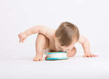 Baby Eats Cake with His Face Bending Over Stock Photo