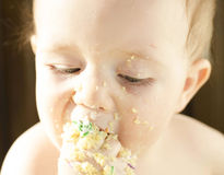 Baby eats cake Stock Images