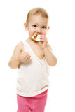 Baby eats candy on a white background Stock Photo