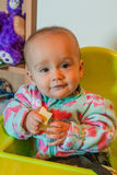 Baby eats cheese Royalty Free Stock Image