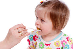 Baby eats Stock Images