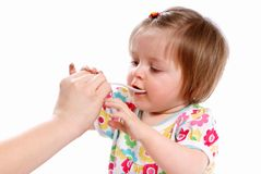 Baby eats Stock Image