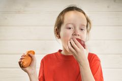 Baby eats. health food. child eats carrot and Apple. vitamins royalty free stock photography