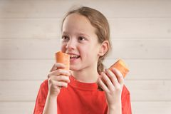 Baby eats. health food. child eats carrot and Apple. vitamins stock images